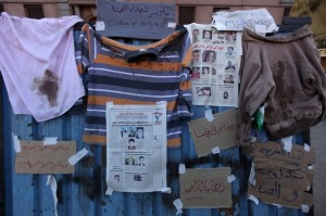 Blood stained shirts and pictures of Egy